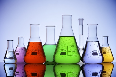 erlenmeyer: group of laboratory flasks with colored liquid inside