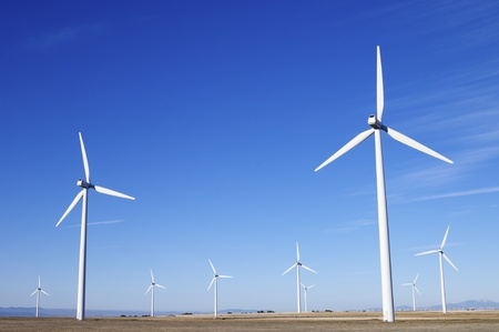group of aligned windmills for electric power generation alternative Stock Photo - 10742912