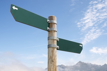 view of two wooden directional signs on a pole Stock Photo