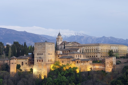 famous view of the Alhambra in Granada, the bottom of the image shows the mountains of Sierra Nevada, Andalusia, Spain