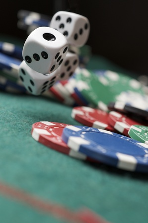 casino chips: roll of the dice on a game table in a casino Stock Photo