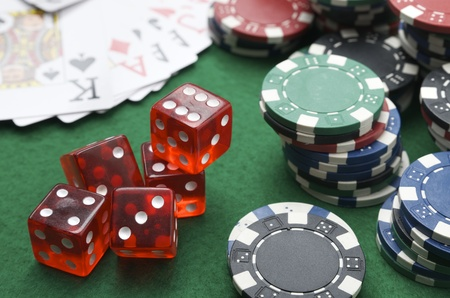 dices, cards and casino chips on a green baize Stock Photo - 11160011