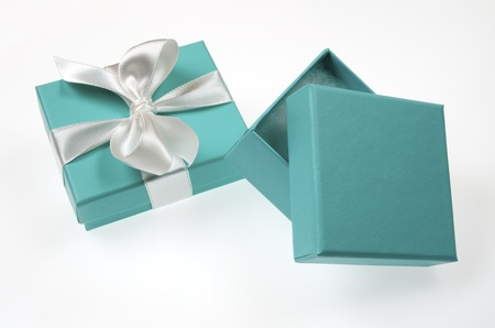 two small turquoise box tied with a white ribbon photo