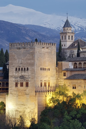 famous view of the Alhambra in Granada, the bottom of the image shows the mountains of Sierra Nevada, Andalusia, Spain Editorial