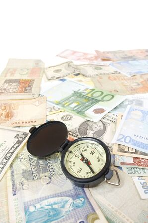 compass and  banknotes of different countries photo