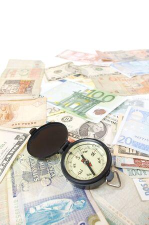 Kompass und Banknoten verschiedener Länder Standard-Bild