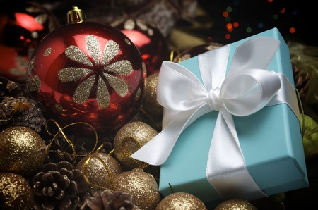 small turquoise box tied with a white ribbon and christmas decoration photo
