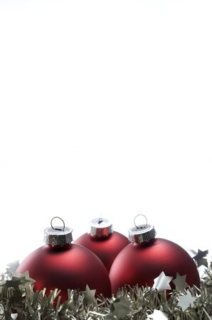 Christmas  decoration red balls and  tinsel with white background photo