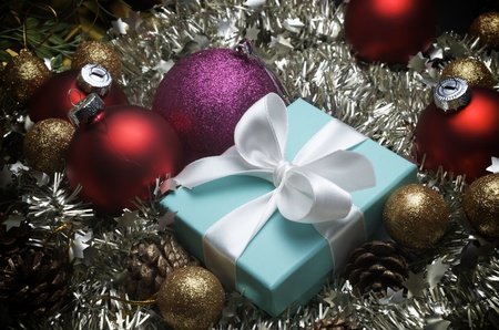 small turquoise box tied with a white ribbon and christmas decoration Stock Photo - 11228500