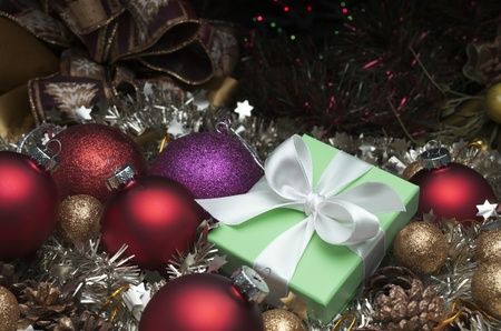 small green box tied with a white ribbon and christmas decoration photo