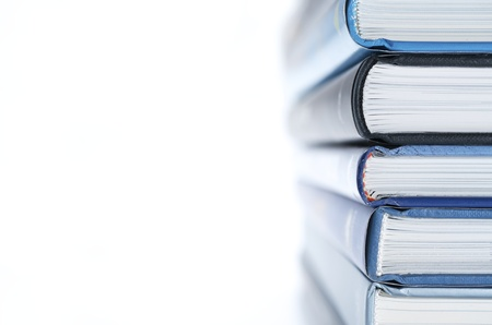 forefront of a group of books stacked Stock Photo