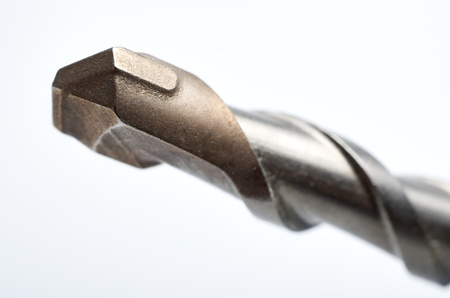 foreground with white background  of a drill bit photo