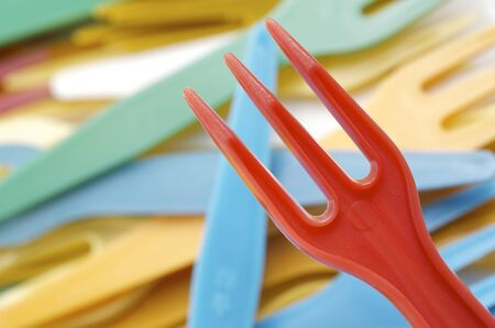 forefront of a group of disposable plastic forks photo