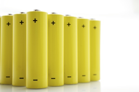 set of AA batteries lined up on a white  background photo