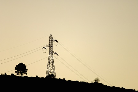 silhouette of a high tension  tower with white sky photo