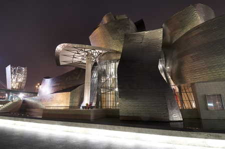 frank gehry: Bilbao, Biscay, Basque Country, Spain, July 30, 2011: night view of the  Guggenheim Museum at night. Guggenheim Museum is dedicated  exhibition of modern art  and was  designed by architect Frank Gehry. Editorial