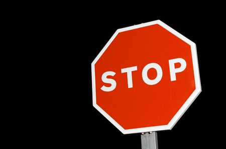 forefront of a stop sign with a black sky Stock Photo - 11378791