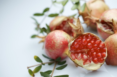 crimson colour: forefront of a pomegranate pieces on a white
