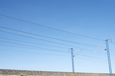 view of a railway catenary  with blue sky Stock Photo - 11721727