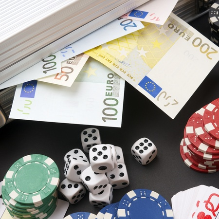 background gambling with euro banknotes, casino chips, cards and dices Stock Photo - 11721762