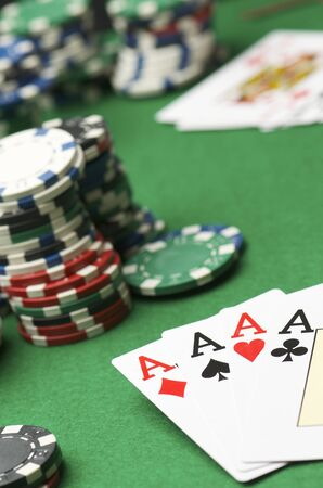 poker aces and gambling chips  stacked on a table Stock Photo - 11721766