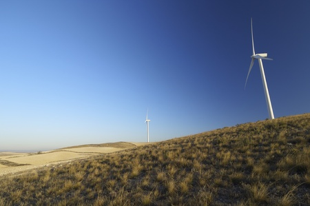 modern windmills for electricity production and grassland Stock Photo - 11872323