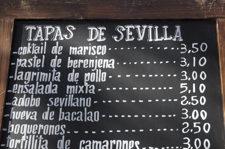 typical: foreground of a  poster of the menu in a typical Spanish restaurant, Sevilla, Andalusia, Spain