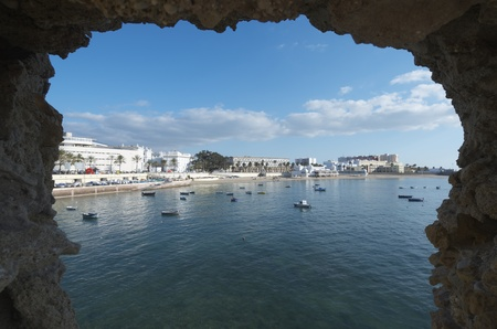 view of the beach of La Caleta, stands  the ancient baths of La Palma, Cadiz, anadalucia, Spain