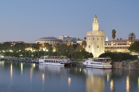andalucia: view of the tower of gold on the banks of the Guadalquivir River, Seville, Andalucia,  Spain