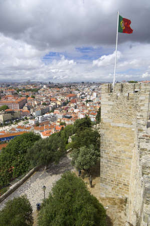 Portuguese flag waving in a tower of the castle of St. George and overview of Lisbon, Portugal photo