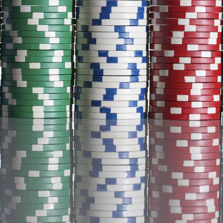 casino chips  stacked on a white table Stock Photo - 12081724