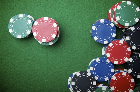 casino chips stacking on a green felt Stock Photo - 12081743