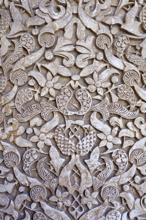 plasterwork: closeup of a plaster wall in the Alhambra Palace, Granada, Andalusia, Spain Editorial