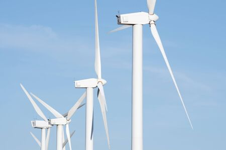 aligned group of windmills for electric power production Stock Photo