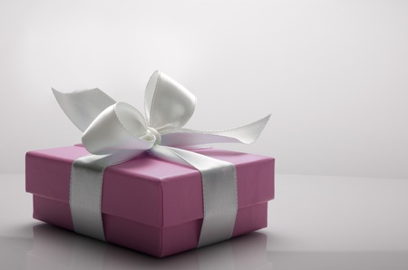 costly: small pink box tied with a white ribbon Stock Photo