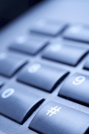 close up of a black telephone keypad