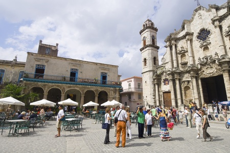 frequented: Havana, Cuba  - January 29, 2007: street scene in the cathedral square, stands the Cathedral of San Cristobal. This is a typical place frequented by visiting tourists. Editorial