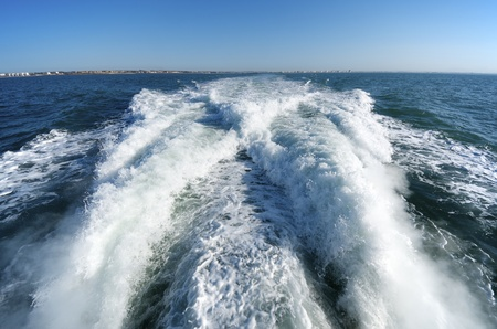 boating: wake of a passenger ship in a clear sky day