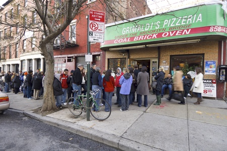 New York, United States - December 29, 2007: people lining up outside  the famous Grimaldis pizzeria in Brooklyn.