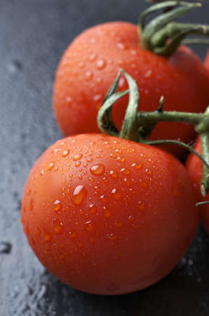 forefront: forefront of a fresh tomatoes on a  slate table