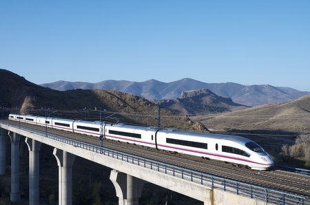 view of a high-speed train crossing a viaduct in Purroy, Saragossa, Aragon, Spain; AVE Madrid Barcelona Editoriali