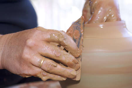 forefront: forefront of the hands of a potter working