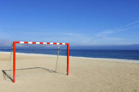 red and white goal with blue sky photo
