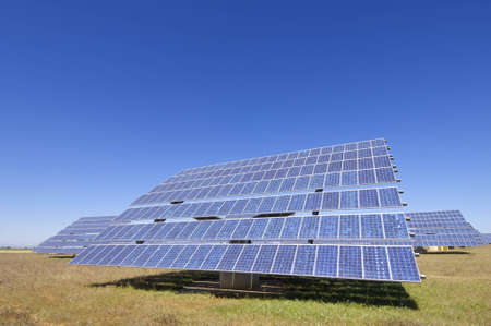 photovoltaic panels for renewable electrical energy production with clear blue sky photo