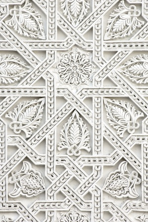 carving: closeup of a wall of white plaster Arabic