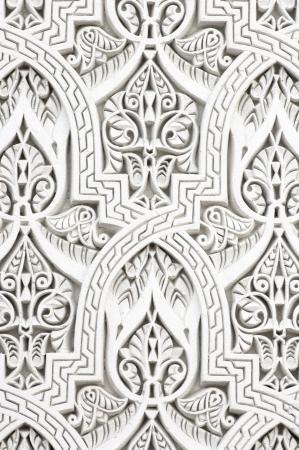 islamic pattern: closeup of a wall of white plaster Arabic