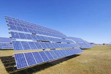 group of photovoltaic solar panels to produce renewable electrical energy photo