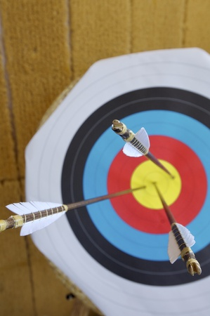 three arrows in the center of a dartboard Stock Photo - 13123394