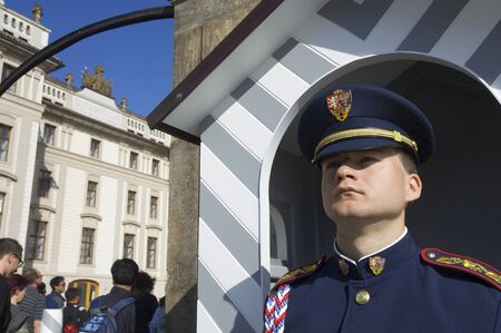 sentry: Prague, Czech Republic - October 12, 2008: A guard stands motionless at the entrance to Prague Castle, along with daily change of guard, this is one of the shows most popular with tourists