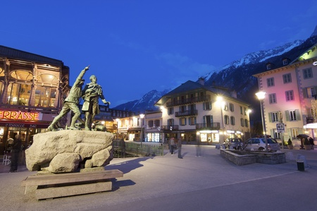 each year: Chamonix, France - April 5, 2009: statue in honor of Balmat and Paccard, first ascent of Mont Blanc.  Chamonix is known as the world capital of mountaineering and is visited by thousands of tourists and mountaineers each year.